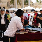 Jewish man observing the scene at the wailing wall